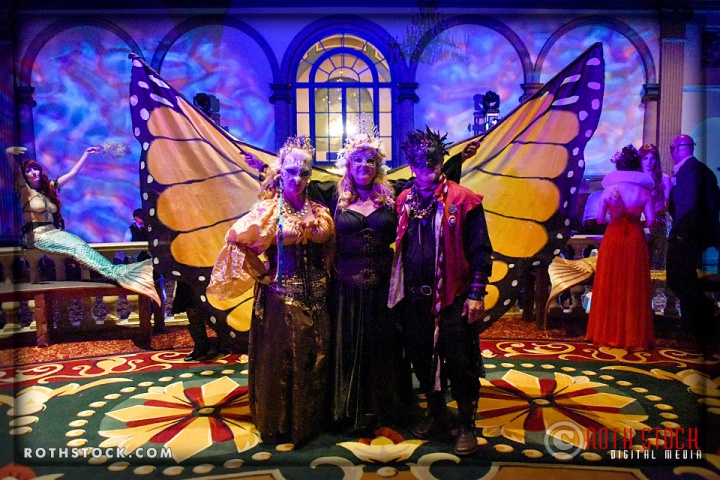 Debi Magruder (center) and guests attend the 18th Annual Labyrinth Of Jareth Masquerade Ball