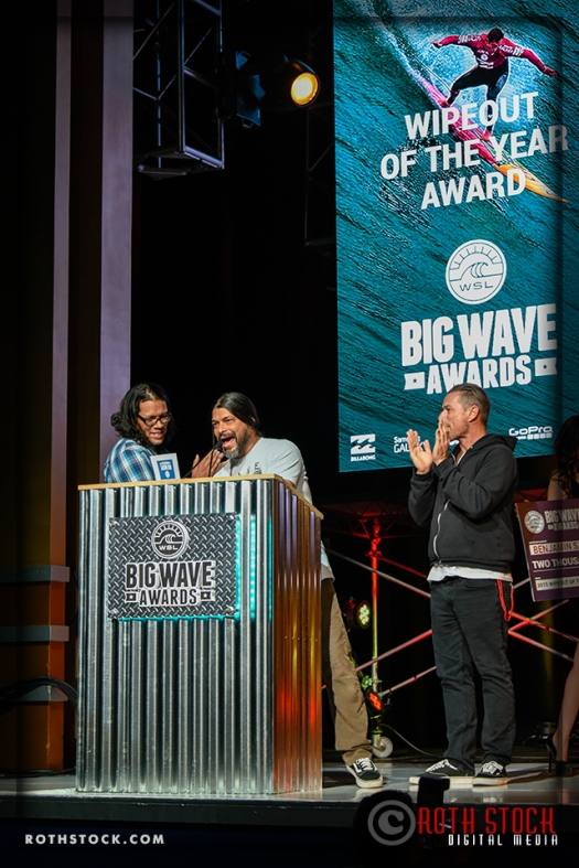Robert Trujillo (C) of the band Metallica presents the TAG Heuer Wipeout of the Year Award to Benjamin Sanchis (R)