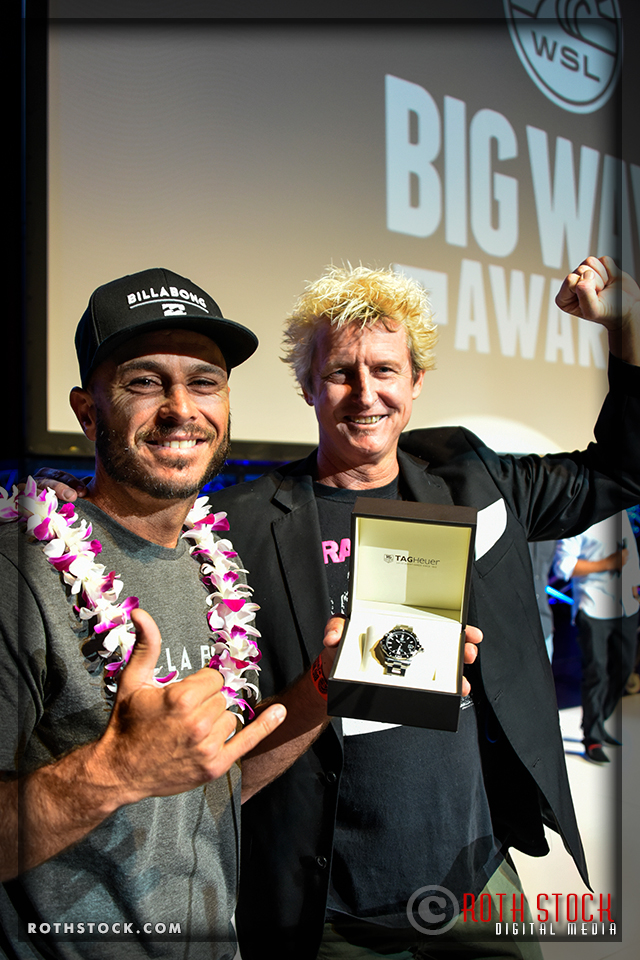 Shane Dorian wins the TAG Hueur Big Wave Award and accepts a sports watch from Bill Sharp, founder of the XXL Big Wave Awards
