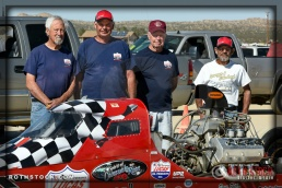 (L-R) Jamie Steinegger, Ted Olsen, driver Albert Echenbaugh and Jim Dunn of Steinegger & Eshenbaugh prepare for their 198.012 mph run at SCTA - Southern California Timing Association's Land Speed Races at El Mirage Dry Lake