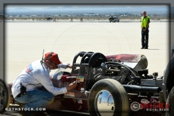 Starting official Ken Carlson signs off on Martin Enyart Huntley's entry at the starting line of SCTA - Southern California Timing Association's Land Speed Races at El Mirage Dry Lake