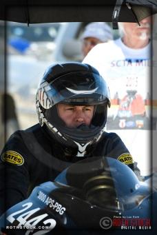 Rider Chris Rivas of Chris Rivas V-Twin prepares for his 228.264 mph run at SCTA - Southern California Timing Association's Land Speed Races at El Mirage Dry Lake