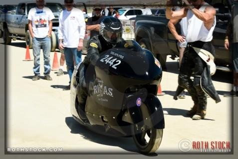 Rider Chris Rivas of Chris Rivas V-Twin on his 228.264 mph run at SCTA - Southern California Timing Association's Land Speed Races at El Mirage Dry Lake