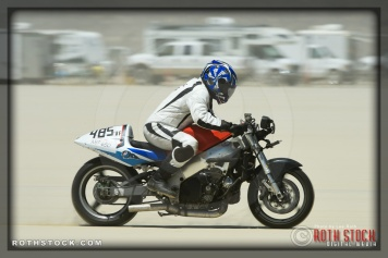 Rider Jim Higgins of Black Art Racing on his 139.253 mph run at SCTA - Southern California Timing Association's Land Speed Races at El Mirage Dry Lake