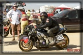 Starting official Ken Carlson with rider Nick Gee of Running Naked Laughing on his 175.965 mph run