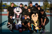 Members of the Wynn Employee Foundation with Homer and Cash the Soccer Rocker